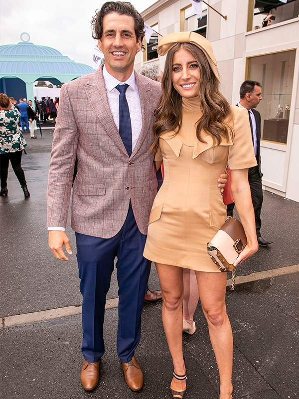 Talk about colour-coordinated! Andy Lee and girlfriend Rebecca Harding kept it neutral. *(Image: Media Mode)*