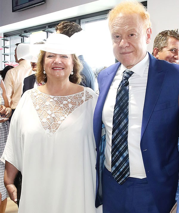 Power players! Mining magnate Gina Rinehart rubs shoulders with fellow billionaire Anthony Pratt at the Melbourne Cup.*(Image: Getty)*