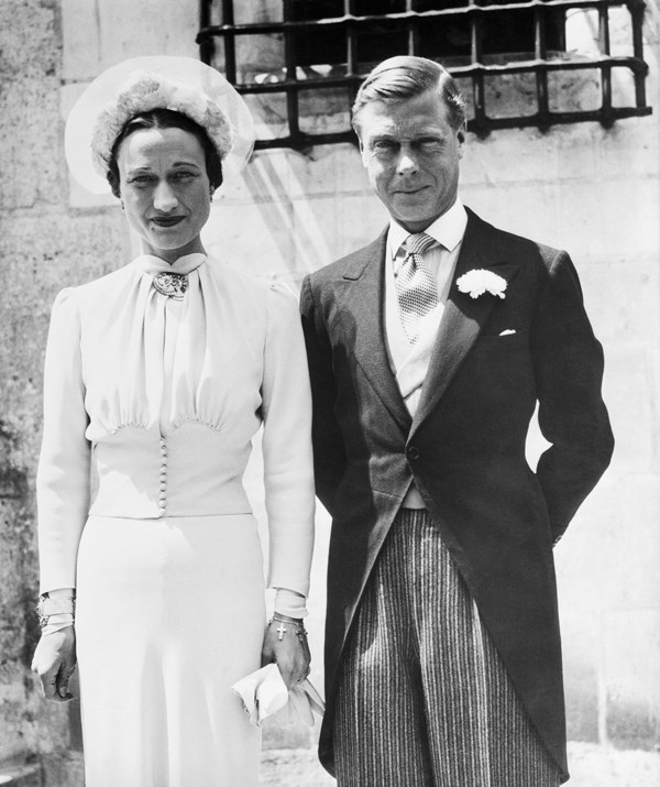 Twice-divorced Wallis Simpson on her wedding day to the former King Edward VIII in 1937. *(Image: Getty Images)*