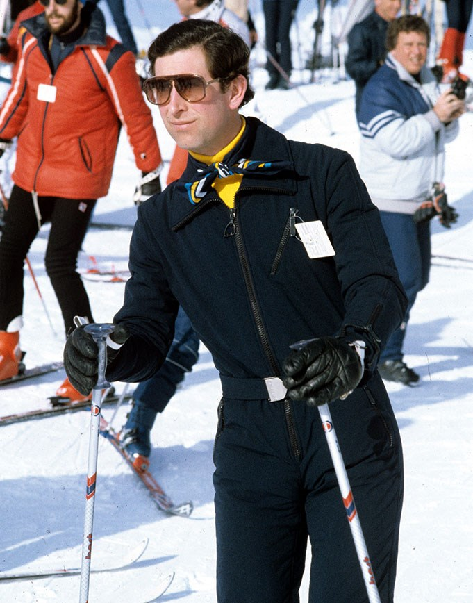 Prince Charles serves some serious style lessons on the slopes in Liechtenstein in 1983. Bonus points for the yellow turtle-neck and snazzy neckerchief. *(Image: Steve Wood/REX/Shutterstock)*