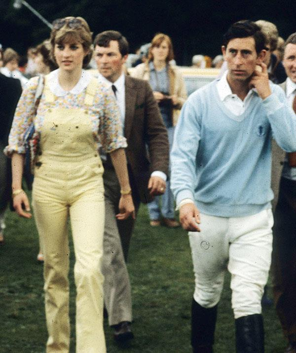 Just weeks before their 1981 wedding, Charles and Lady Diana Spencer turned heads at the polo at Windsor Great Park. Now, where do we get a pair of Diana's adorable dungarees? *(Image: Getty)*