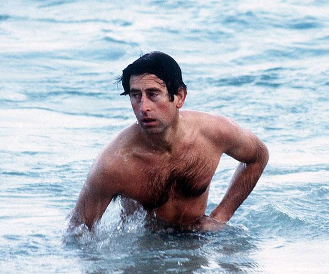 The prince takes a dip at Cottesloe Beach in Perth, Australia back in 1983. *(Image: Getty)*