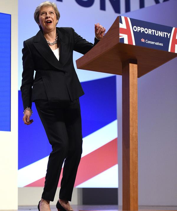 The British PM just can't help herself when it comes to dancing. *(Image: Getty Images)*