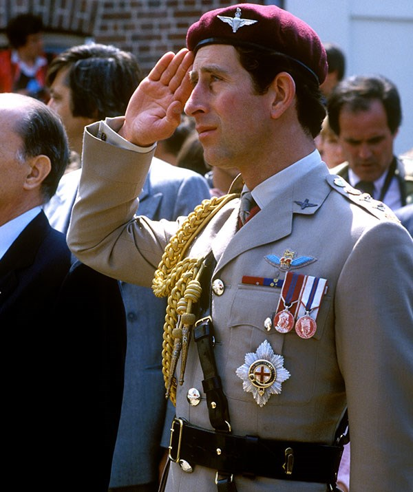 Charles shows a sign of salute during a visit to Bruneval in Normandy, France, to officially open a war memorial in 1982. *(Image: Getty)*