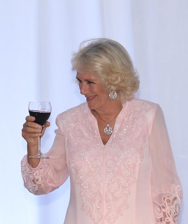 "'Don't mind if I do!"" Camilla toasting her presidential hosts at last night's State Dinner in Ghana. *(Image: Getty Images)*"