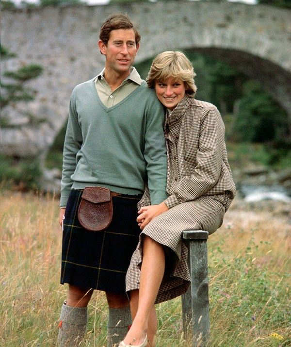 With all the hope in the world under their wings, Prince Charles and Princess Diana bask in their newlywed glow on honeymoon in Balmoral, Scotland in 1981. *(Image: Getty)*