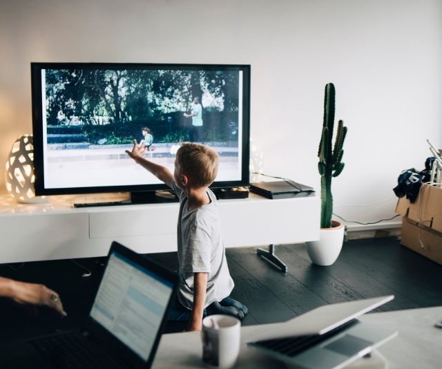 **Hot tip:** Television sets are easily pulled over onto small bodies. For the safety of your child, place your television, stereo, and other electronic equipment out of reach in cabinets, or wall mounted where possible. *Image: Getty Images.*