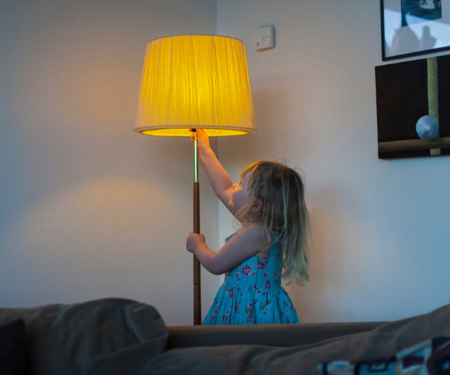 **Child friendly lamps and lighting:** Floor lamps might look pretty, but once kids are on the scene they provide some hazards as they are easily pulled over exposing children to electricity and often burning globes. Best practise for lamps and lights is to keep them in a high secure position where children to not have access to the globe or the cords. Using a reduced wattage or LED globe is also a good idea. If you are concerned about the cords you can always use tape to secure them to the floor or skirting. This will help reduce choking and electrical risk. *Image: Getty Images.*