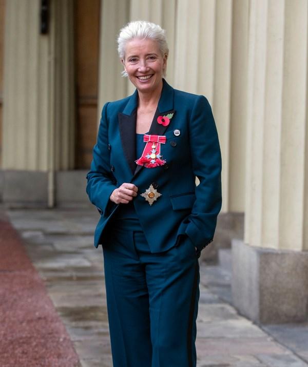 Dame Emma Thompson beams outside Buckingham Palace. *(Image: AAP)*