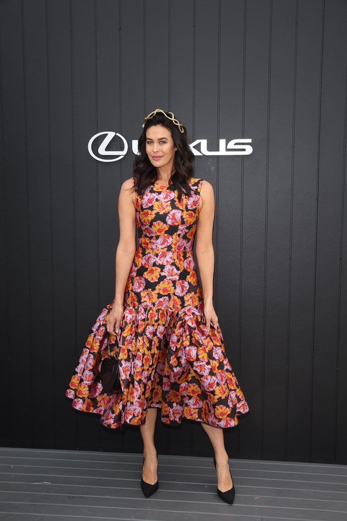 Aussie darling and model, Megan Gale's festive floral gown is a head turner. *(Source: Media Mode)*