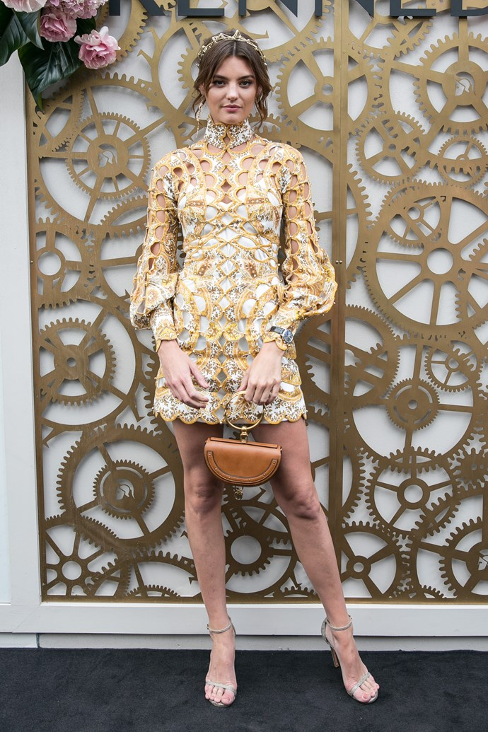 Aussie model, Montana Cox, is rocking this gold number - even if it is matching the backdrop. *(Source: Media Mode)*