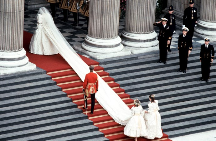 A train as far as the eye can see! Princess Diana made her grand entrance into St Paul's Cathedral with a frock that didn't do things by halves! *(Image: Getty)*