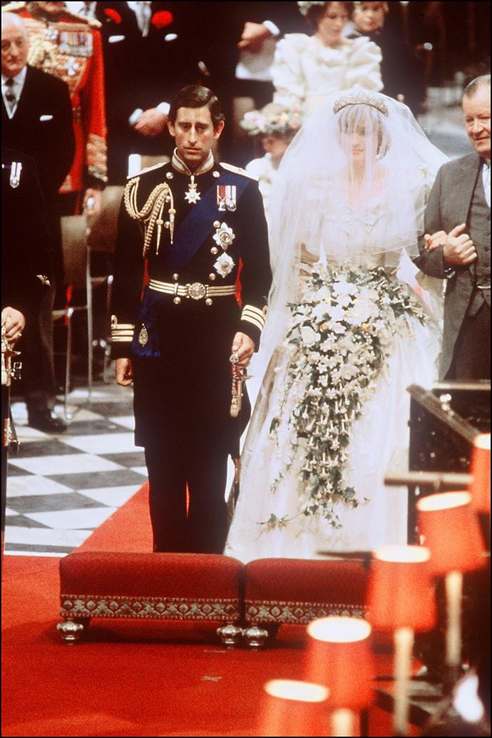 Charles wore his full naval commander uniform for the service, while a nervous Diana stumbled her words as she said her vows. *(Image: Getty)*
