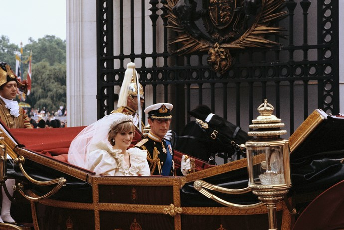 It wouldn't be a royal wedding without a carriage procession! The couple smiled and waved to thousands of onlookers who lined the streets following the wedding. *(Image: Getty)*