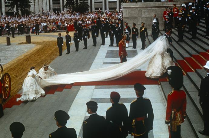 Diana's ivory silk taffeta and antique lace gown was valued at a whopping AUD $270,000. *(Image: Getty)*
