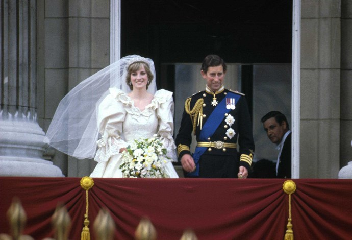 In true royal tradition, the newlyweds took to the balcony of Buckingham Palace for - you guessed it - more pictures! *(Image: Getty)*