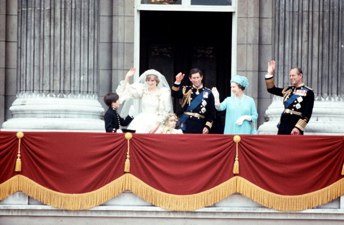 Much to the crowds delight, the Queen and Prince Phillip also joined the couple on the balcony. *(Image: Getty)*