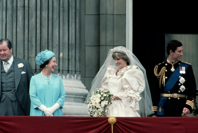 We'd be amused by all those royal fanatics too! The Queen and Diana shared a chuckle on the balcony. *(Image: Getty)*