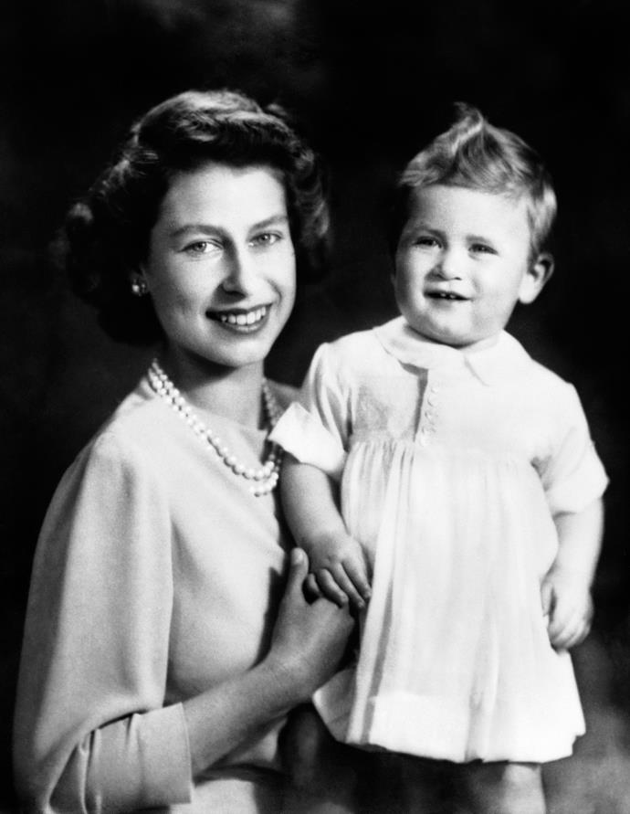 Those cheeks! Queen Elizabeth looked every bit the doting mum as she and Charles posed for a photo. *Image: Getty Images*