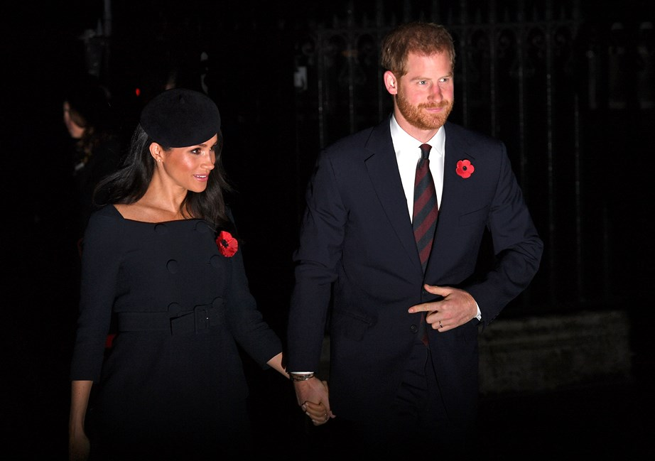 Meghan wore a flattering navy boatneck top with a matching hat while Harry looked dapper in a dark suit.