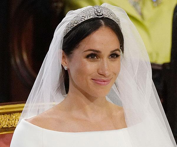 After much dismay, Meghan opted for Queen Mary's Diamond Bandeau for her big day. *(Image: Getty)*