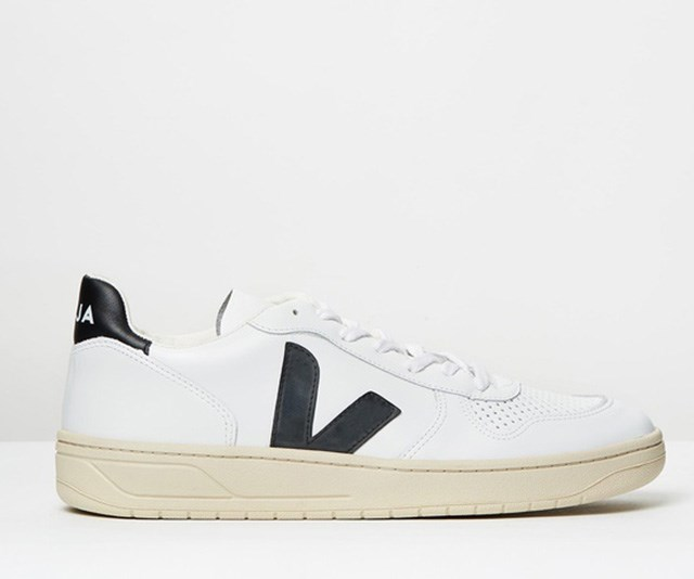 Meghan's white Veja sneakers cost significantly less than what her usual royal budget allows. *(Image: The Iconic)*