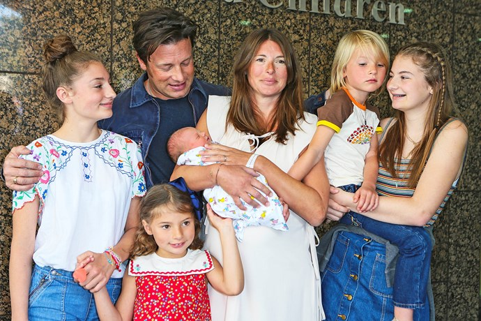 The couple have their hands full with their five children (from left) Daisy, Petal, River, Buddy and Poppy.