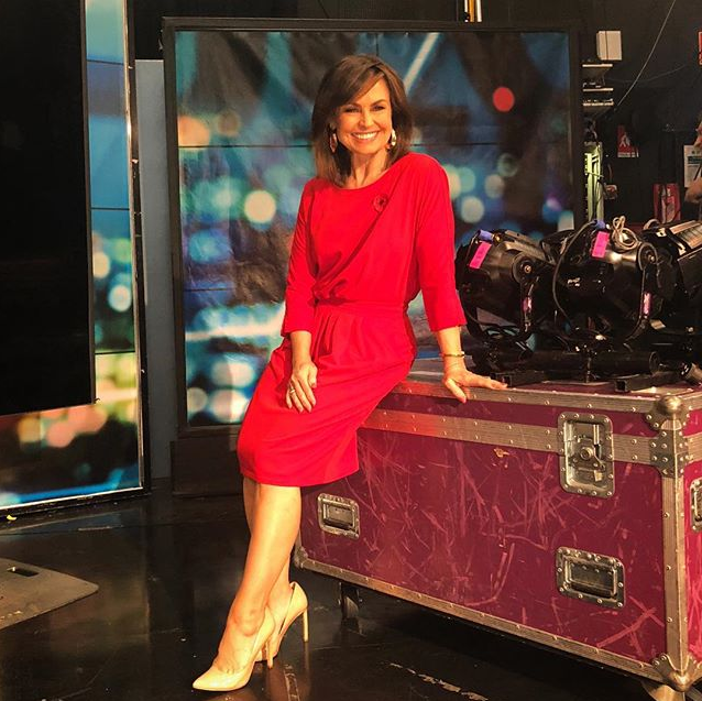 Lisa shared this image of herself wearing the stunning red dress with her fans. *(Image: Instagram / @lisa_wilkinson)*