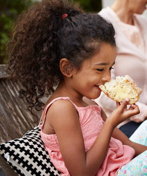 Eating outside where there's plenty of space to run around is a huge drawcard for families. *(Image: Getty)*