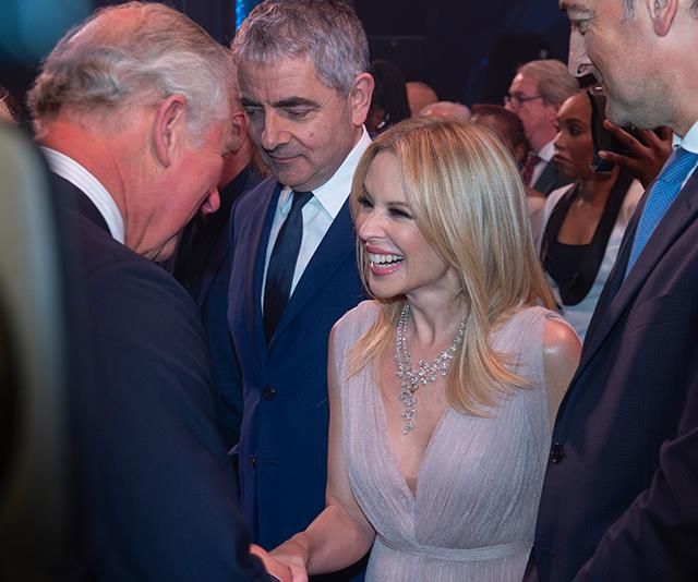 Princess of Pop Kylie Minogue looked thrilled to celebrate with the Prince! *(Image: AAP)*