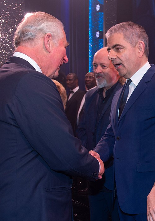 Rowan Atkinson was quick to joke with the Prince during their brief encounter. *(Image: AAP)*