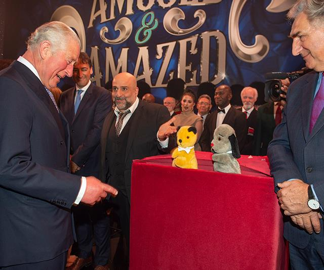 Charles had a humorous run-in with puppets Sooty and Sweep. *(Image: AAP)*