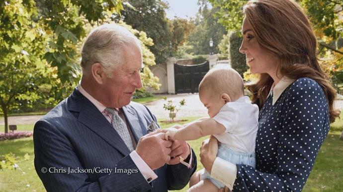 Royal fans are being treated to a multitude of stunning never-before-seen images of the royal family for Charles' birthday. This image shows a beautiful moment between the 70-year-old and his youngest grandson, Prince Louis. *(Image: Chris Jackson/Getty Images)*
