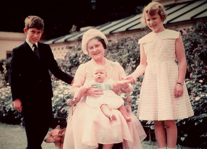 Queen Elizabeth, the Queen Mother with her grandchildren Prince Charles, Princess Anne and Prince Andrew. *(Image: Getty)*