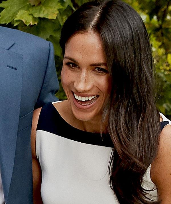 Having a hoot! What's so funny, Duchess Meghan?