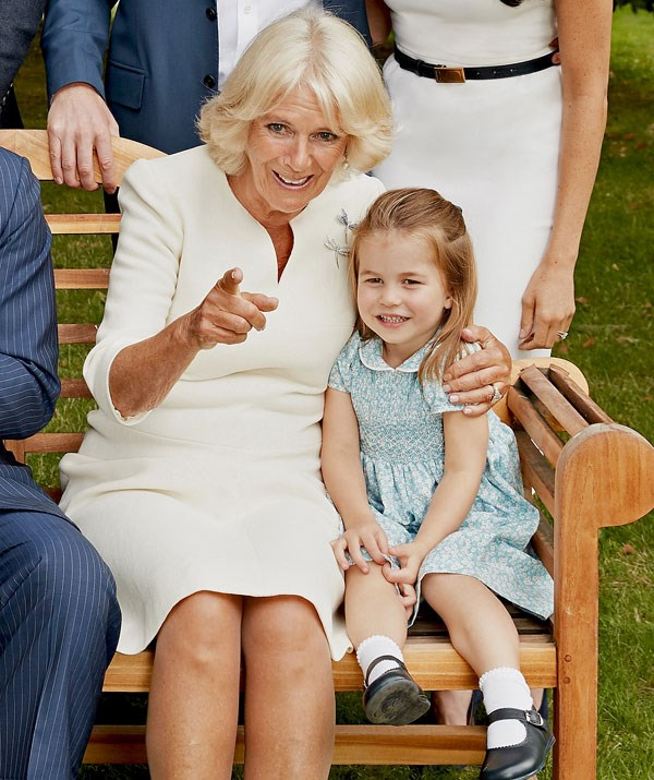Aww, Duchess Camilla and Princess Charlotte share a cuddle.