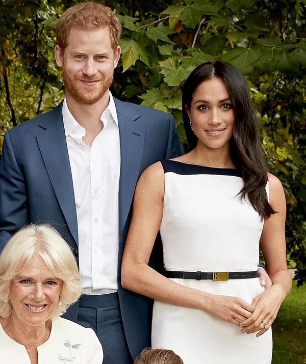 Father to-be Prince Harry can't help but shower his wife with affection.