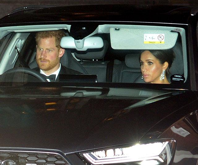 Prince Harry and Duchess Meghan arrive for a night of celebrations. *(Image: Getty)*