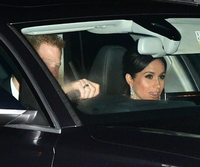 Meghan opted for a pair intricate silver earrings. *(Image: Getty)*