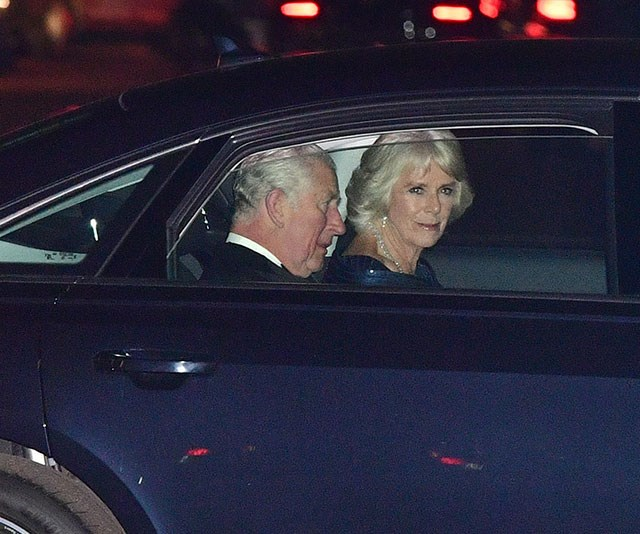 The man of the hour, Prince Charles, arrives with wide Duchess Camilla. *(Image: Dominic Lipinski/AP)*