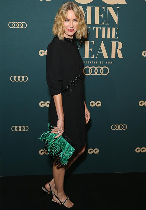 Australian actress Naomi Watts' lob and bright green feathered clutch brightened up her dark ensemble.  (Image: Getty)