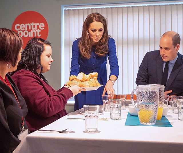 The royals got stuck into the kitchen as they cooked for guests at a charity for young homeless people. *(Image: Getty)*