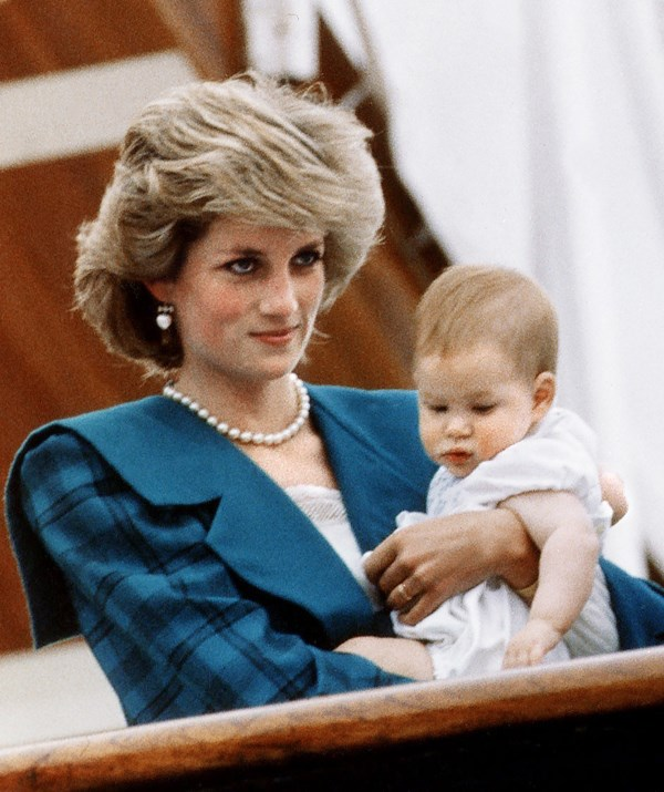 Princess Diana cradling eight-month-old Prince Harry on the Royal Yacht Britannia in 1985. *(Image: Getty)*