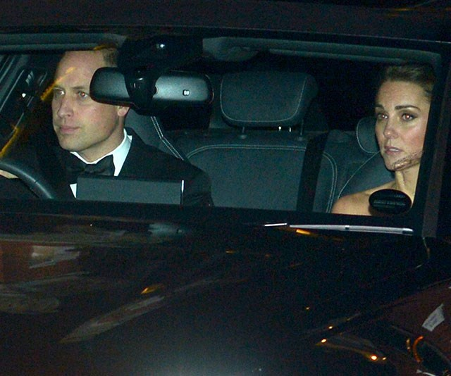On their way to Pa's bash! Prince William drives Duchess Catherine through the gates of the Palace. *(Image: Getty)*