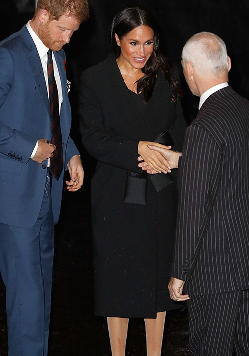 Duchess Meghan surprised fans by stepping out in an affordable, yet stunning black dress for a formal event in London. *(Image: Getty)*