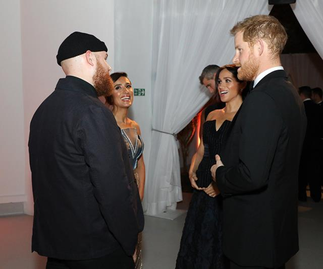 The Duke and Duchess of Sussex mingled with guests during the fancy event. *(Image: Twitter / @IamTomWalker)*