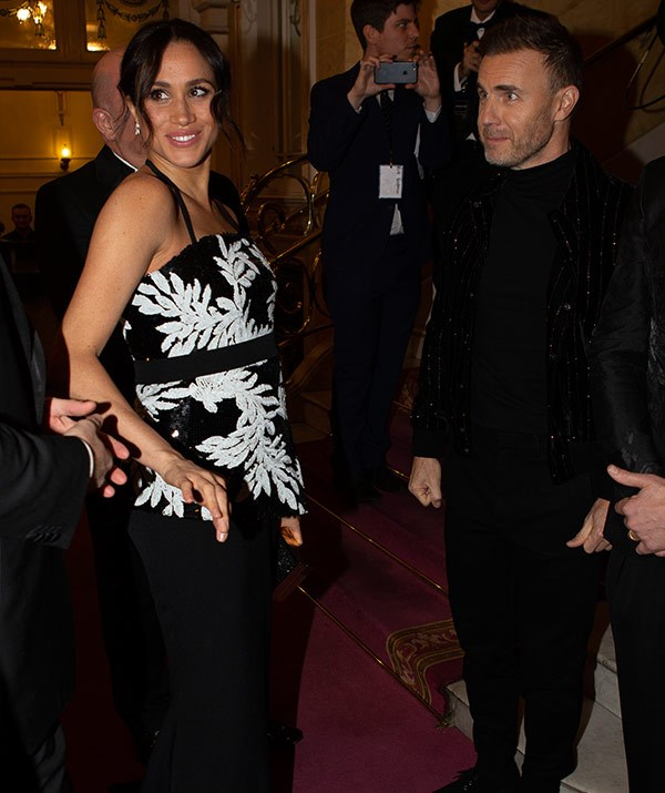 Meghan chats to Take That's Gary Barlow backstage.