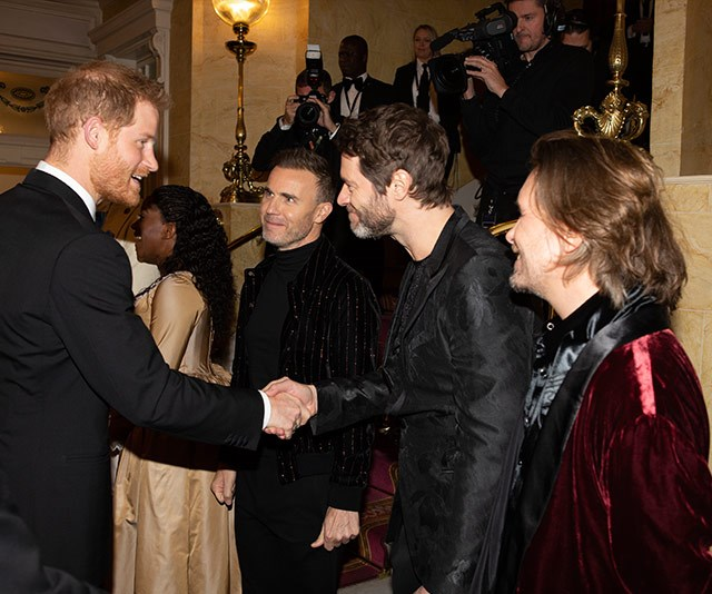 When royals and popstars collide! Prince Harry greets Gary Barlow, Howard Donald and Mark Owen of Take That.