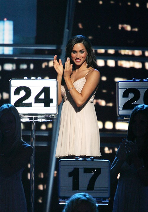 Meghan worked with Chrissy on the hit game show *Deal or No Deal*. *(Image: Getty)*