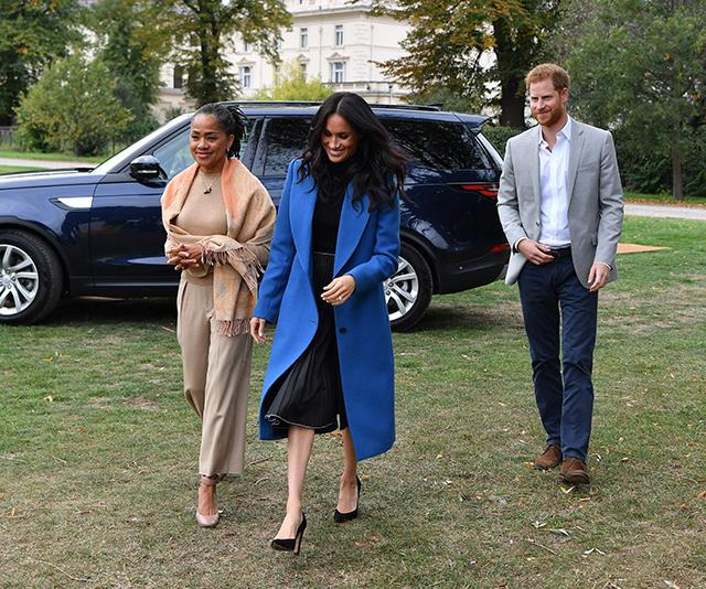 The Duchess was joined by Harry and mum Doria for her charity cookbook launch in September. *(Image: Getty Images)*